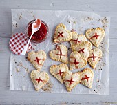 Small heart-shaped pies filled with ricotta and strawberries (seen from above)