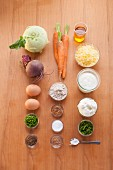 Ingredients for vegetarian beetroot fritters with herb dip