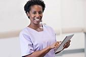 Woman nurse using tablet