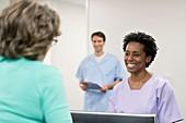 Nurse smiling towards female patient