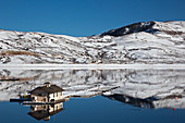 Floating dock on a reservoir in winter, USA