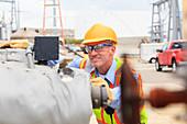 Electrical engineer examining pressure sensor