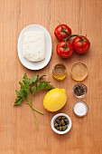 Ingredients for halloumi with tomato and caper sugo
