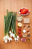 Ingredients for grilled spring onions with Romesco tomato and red pepper sauce