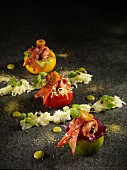 Yellow, red and green tomatoes with different fillings