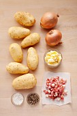 Ingredients for fried potatoes with onion and bacon