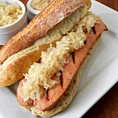 A sandwich with grilled kielbasa and sauerkraut (Poland)