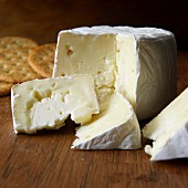 French petite creme Brie on board with crackers