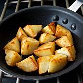 Fried potatoes in frying pan