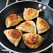 Potayo filled pierogies (Pirogi) browned in skillet