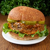 Meatloaf sandwich with dill pickle and lettuce