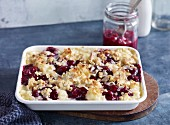 Rice pudding and cherry bake with coconut flakes