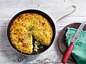 A Spanish tortilla with potato, celery and carrot