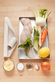 Ingredients for fish fillet with vegetables cooked in parchment paper