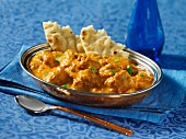 Indian butter chicken (Murgh Makhani) with naan bread