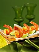 Crispy prawns with lime wedges