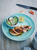 Lemon chicken in a coconut marinade with spicy cucumber salad