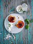 Grilled peach halves with coconut and mint yoghurt