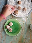 Energy balls with macadamia nuts, coconut and dried pineapple