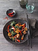 Vegan wok-fried kale and red pepper with diced tofu (Sirtfood)