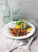 Lemon scaloppine with orange and rocket salad