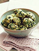 Spinach dumplings with herbs and Parmesan