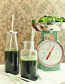 Spinach and spirulina smoothies in bottles
