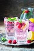 Raspberry lemonade with lemon slices and mint