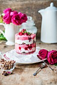 Rose water parfait with cereal and raspberries