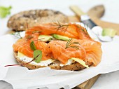 Bagel with smoked salmon, fresh cheese and avocado