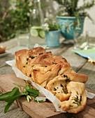 Garlic bread on a chopping board