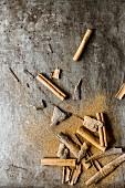 Cinnamon sticks, cassia bark and cinnamon powder on a metal tray