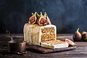 Fig and caramel cake decorated with fresh figs and caramel sauce