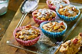 Apple muffins with raisins in colourful paper cases