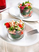 Fresh mixed salad with cherry tomatoes of Pachino and canned salmon in olive oil, Italy