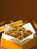 Toffee cookies in a biscuit box