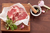 Raw beef steaks with the matching herbs and spices