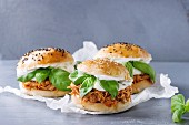 Homemade mini burgers with pulled chicken, basil, mozzarella cheese and yogurt sauce