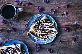 Crepes with dark chocolate drizzle and Brazil nuts