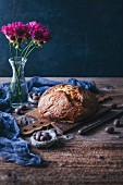 Freshly baked sweet Easter bread on a wooden board