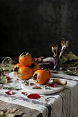 Fresh persimmons on a kitchen table