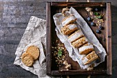 Set of homemade ice cream sandwiches in oat cookies with almond sugar crumbs on baking paper