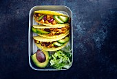 Mexican tacos with chopped jackfruit, kidney beans, corn and avocado (vegan)