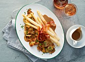 White asparagus with bacon, potato crisps and rose wine
