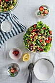 Strawberry Pasta Salad with herbs and cucumber in a bowl