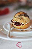 A poppy seed roll with jam