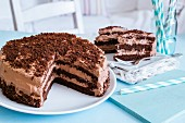 A sliced chocolate cream torte