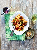 Pasta puttanesca salad with pine nuts