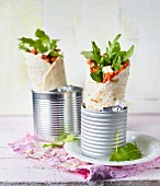 Lahmacun style wraps with rocket served in tin cans