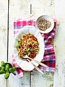 Ribbon noodles with lentil bolognese and sunflower seeds